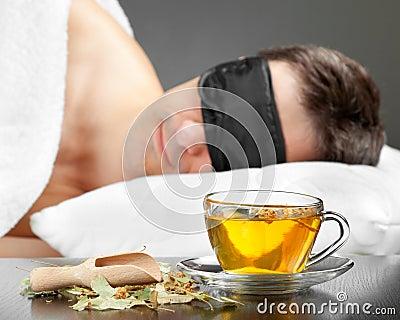 Man with Sleeping mask sleep on a bed