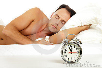 Man sleeping, retro alarm clock