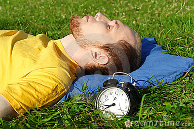 Man sleeping on summer meadow