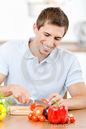Man slicing groceries for breakfast