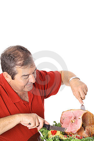 Man slicing a ham vertical