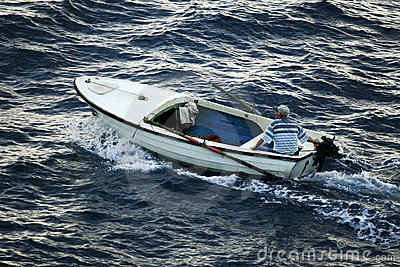 Man in small motorboat