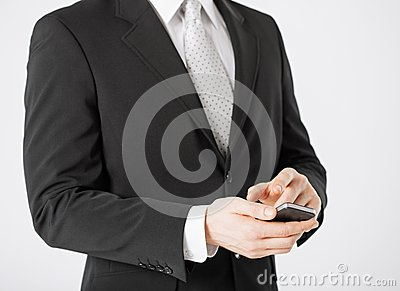 Man with smartphone typing something
