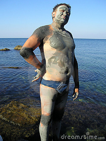 Man, smeared by mud at sea