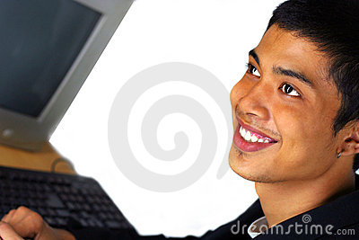 Man smile at front of computer