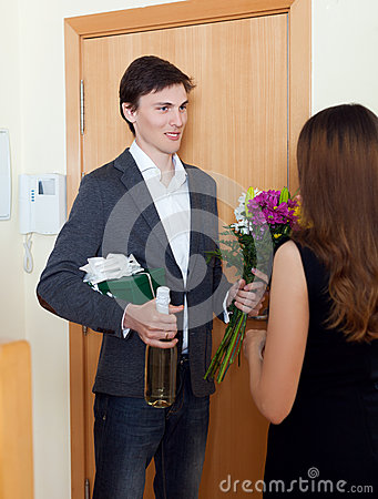 Free Man Smiling And Give Bunch Of Flowers To His Wife Royalty Free Stock Photos - 44674108
