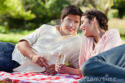 Man smiling as he looks at his friend during a picnic