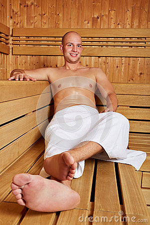 Man smiling in sauna