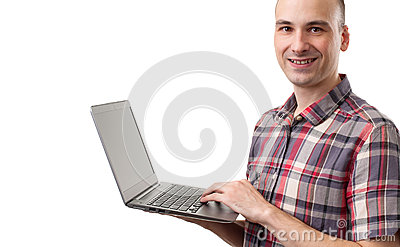 Man smiling using laptop