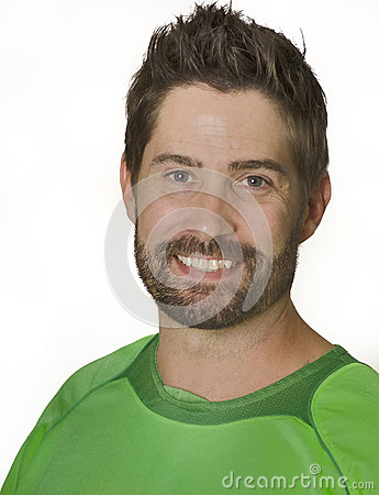 Man smiling wearing green soccer football shirt