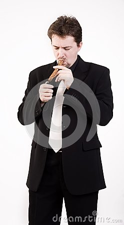 Man smokes cigar