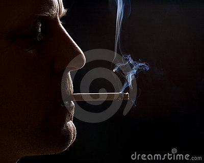 The man smokes a cigarette