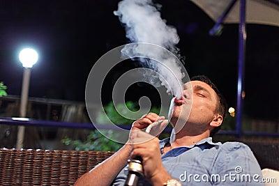 Man smokes hookah