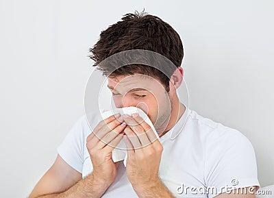 Man Sneezing Into A Tissue Stock Photo - Image: 47177089