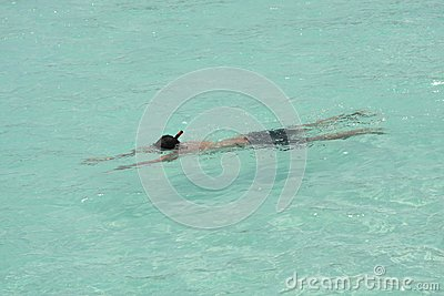 Man snorkeling in crystal clear