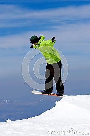 Man snowboarding on slopes of Pradollano ski resort in Spain