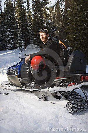 Man on snowmobile.