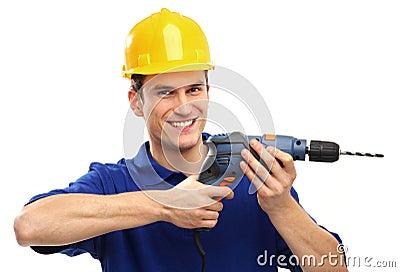 Man som använder drillborren