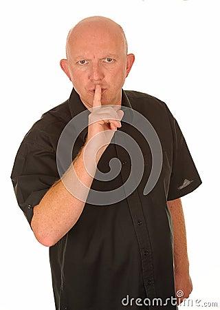Man som göra en gest för quiet
