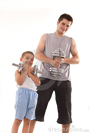 Man and son exercise at gym