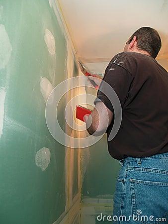 Man spackling new drywall