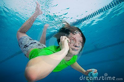 Man speaking on the cell phone underwater