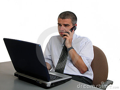 Man speaking to the phone at the office desk