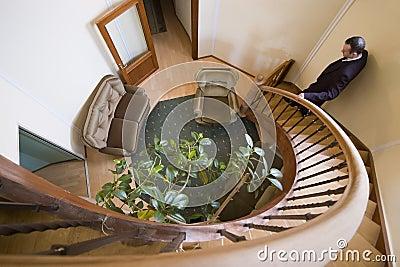 Man on spiral stairs