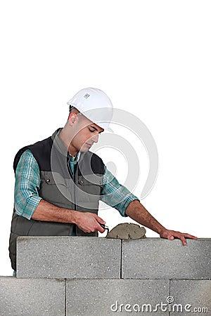 Man spreading mortar