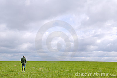 Man standing alone in a field