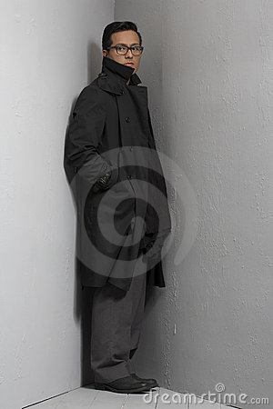 Man standing in corner with trench