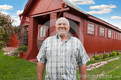 Man standing at the country house