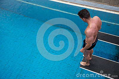 Man Standing On Diving Board At Public Swimming Pool Stock Photos Image 33431343