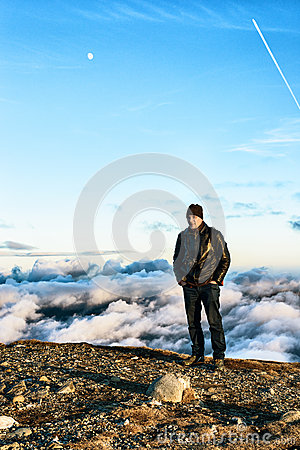 Man standing at the edge of a peak