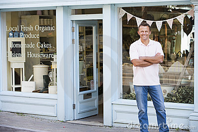 Man standing in front of organic food store