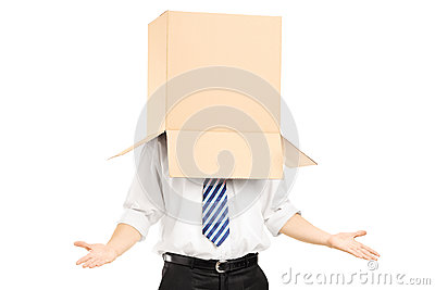 Man standing and gesturing with a cardboard box on his head