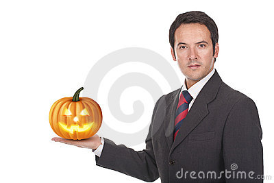 Man standing with a halloween pumpkin on his hand