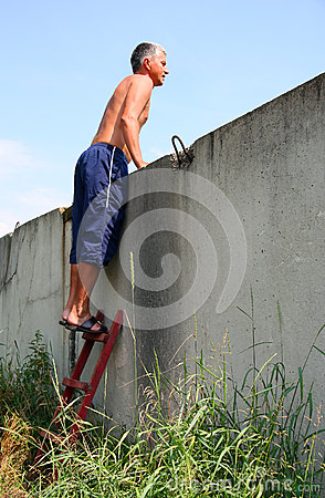 Man standing on a ladder