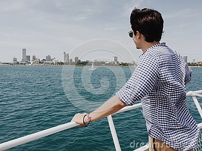 Man Standing On Powerboat And Looking On Body Of Water During Daytime Free Public Domain Cc0 Image