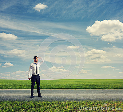 Man standing on road and looking forward