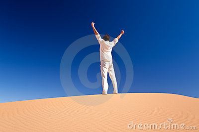 Man standing on a sand dune