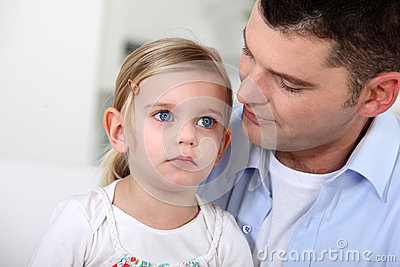 Man staring at his daughter