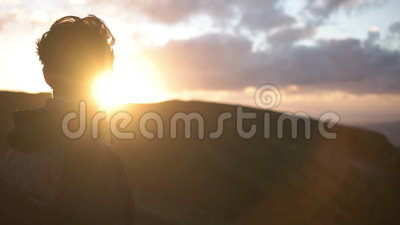 Man Staring into the Sunset. Young caucasian man staring into the sunset on Azores Island