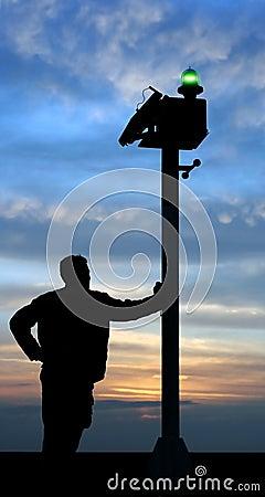 Man starring at the horizon nearby green lantern