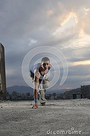 Man on the start position ready to run