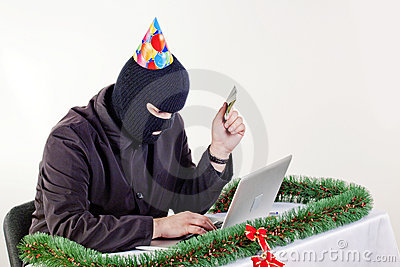 Man stealing data from a laptop