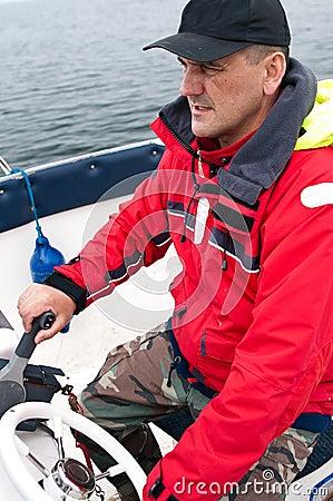 Man steering motor boat
