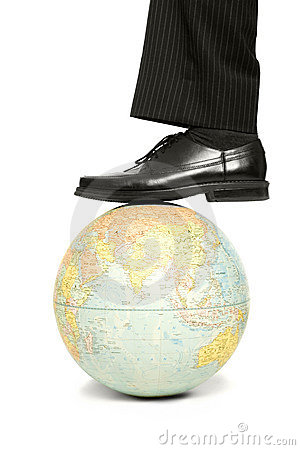 A man steps on a globe