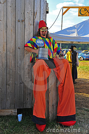 Man on stilts takes a break Editorial Image