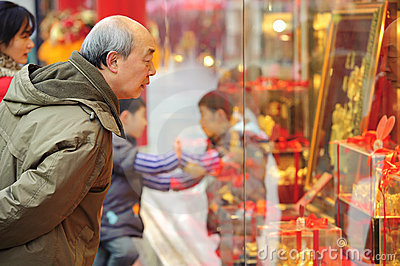 A man stop to look in the window of a gold shop Editorial Stock Photo